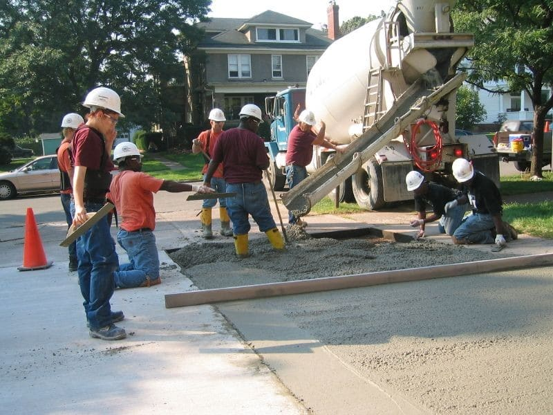 Iroquois Job Corps students performing concrete work at Medina Armory